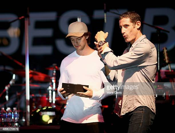 Actor Patrick Schwarzenegger and professional cyclist George Hincapie speak onstage at the Hearst Ranch Barbeque Celebration and Concert during the...