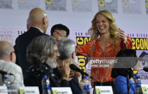 Actor Patrick Stewart and actress Jeri Ryan appear on onstage during the Star Trek: Picard panel in Hall H at the Convention Cener during Comic Con...