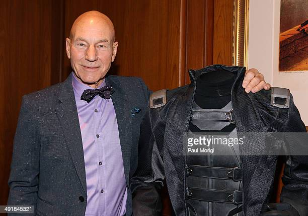Actor Patrick Stewart poses for a photo next to his Professor Xavier costume at the presentation of specially selected XMen items to the...