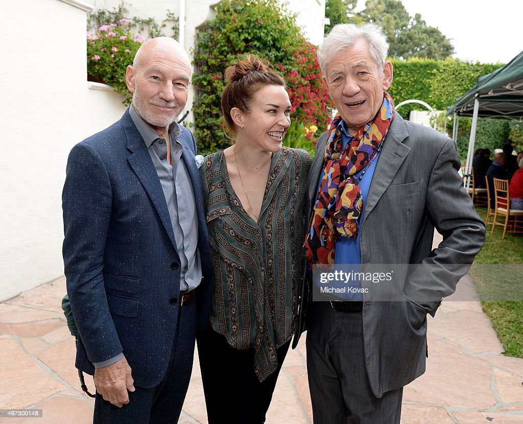 Actor Patrick Stewart, singer Sunny Ozell, and actor Ian McKellen attend Brunch With Sir Ian McKellan Hosted By British Consulate-General at British Consul General's Residence on November 15, 2015 in Los Angeles, California.