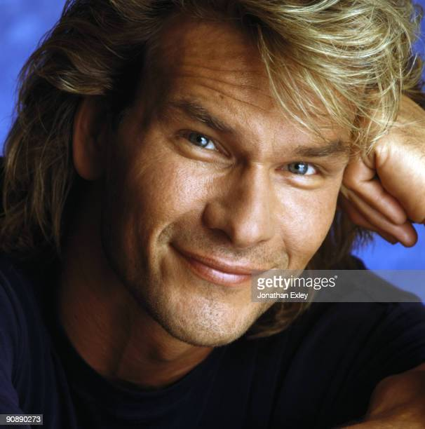 Actor Patrick Swayze poses at a portrait session