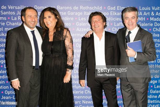 Actor Patrick Timsit Fati Rosenberg a guest and Stanislas Lyonnet attend the 'Heroes for Imagine' host by Kamel Mennour benefit auction at L'Institut...