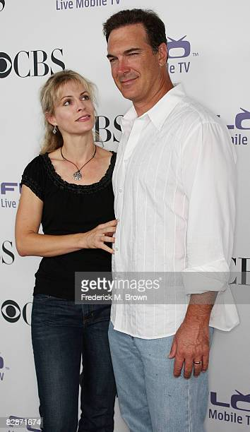 Actor Patrick Warburton and his wife attend the CBS Comedies' Season Premiere Party at Area on September 17 2008 in Los Angeles California