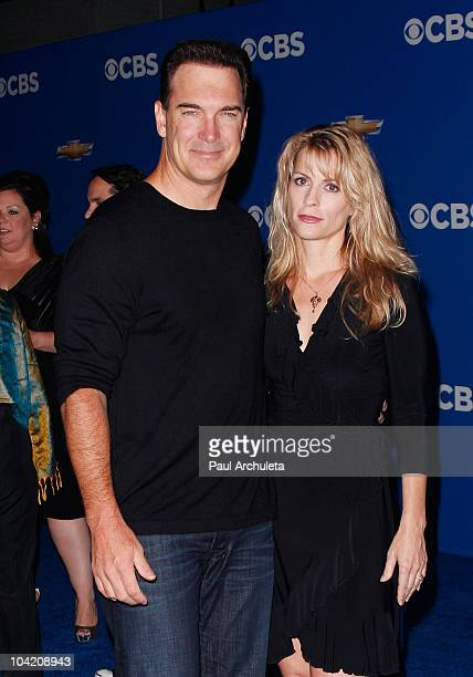 Actor Patrick Warburton and his wife Cathy Warburton arrive at the CBS Fall Season premiere party on September 16 2010 in Los Angeles California