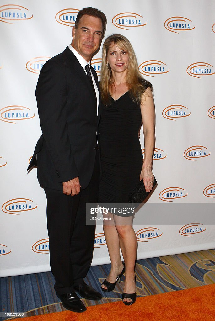 Actor Patrick Warburton (L) and wife Cathy Jennings attend Lupus LA 13th Annual Orange Ball Gala at Regent Beverly Wilshire Hotel on May 9, 2013 in Beverly Hills, California.