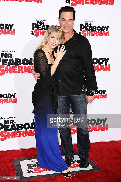 Actor Patrick Warburton R and wife Cathy Jennings attend the premiere of Mr Peabody Sherman at Regency Village Theatre on March 5 2014 in Westwood...