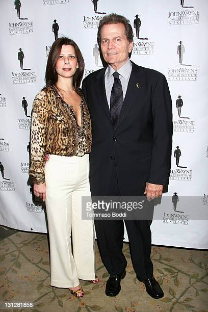 Actor Patrick Wayne and Misha Anderson attend the John Wayne Auxiliary Luncheon held at the Beverly Hills Hotel on November 3 2011 in Beverly Hills...