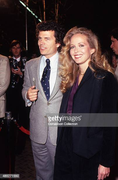 Actor Patrick Wayne attends and event with a woman in March 1980 in Los Angeles California
