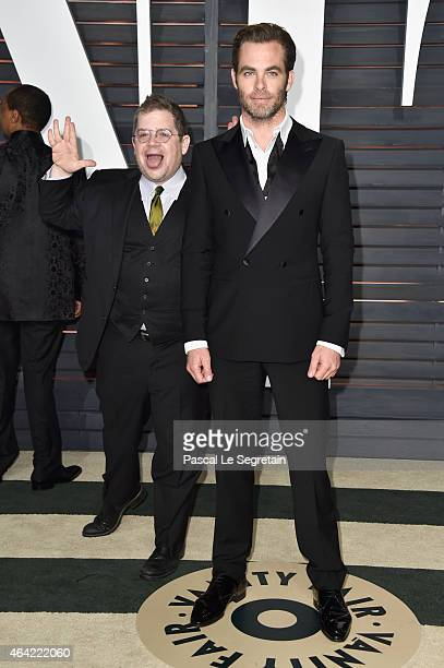 Actor Patton Oswalt photobombs actor Chris Pine at the 2015 Vanity Fair Oscar Party hosted by Graydon Carter at Wallis Annenberg Center for the...