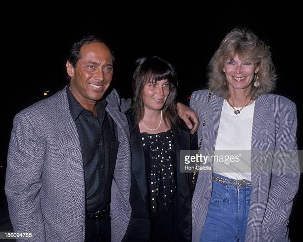 Actor Paul Anka wife Anne DeZogheb and daughter being photographed on March 21 1989 at Spago Restaurant in West Hollywood California