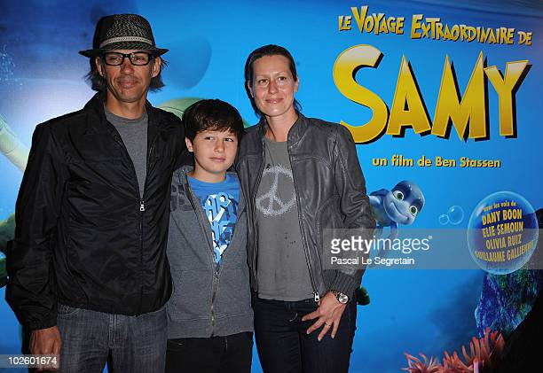 Actor Paul Belmondo poses with son Giacomo and wife Luana as they attend the Paris Premiere of the film 'Le Voyage Extraordinaire de Samy' at Cinema...