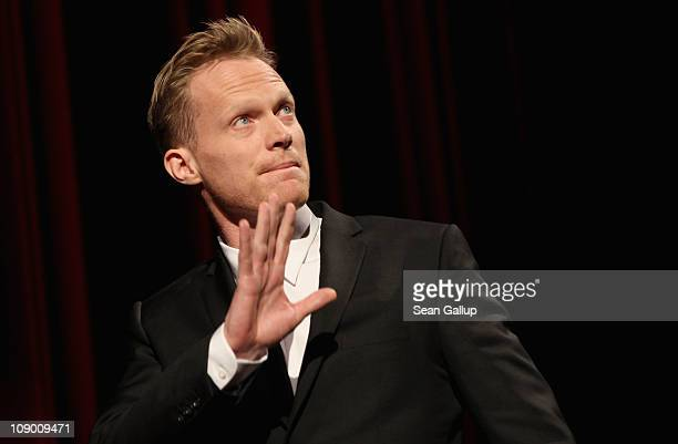 Actor Paul Bettany gestures on stage after the 'Margin Call' Premiere during day two of the 61st Berlin International Film Festival at Berlinale...