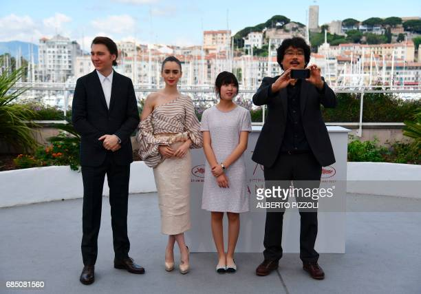 US actor Paul Dano British actress Lily Collins South Korean actress Ahn Seohyun and South Korean director Bong Joonho pose on May 19 2017 during a...