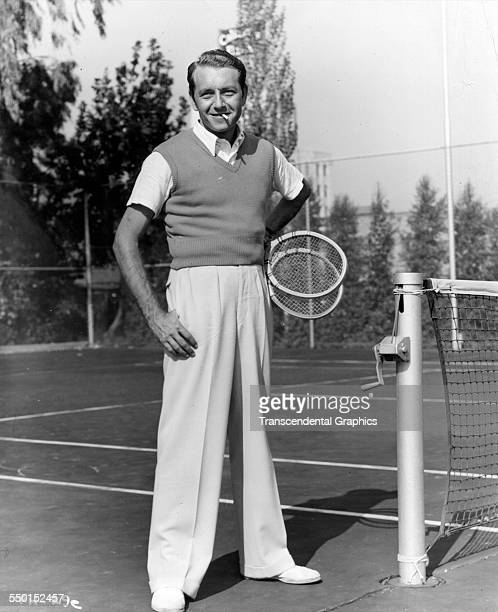 Actor Paul Henreid pauses for a photo by the tennis courts while on vacation Florida circa 1940