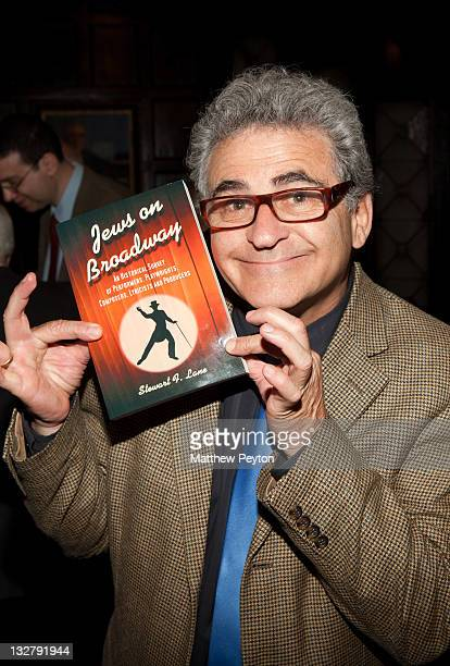 Actor Paul Kreppel poses with a book at the Book Signing for Stewart F Lane's Jews on Broadway at New York Friars Club on May 11 2011 in New York City