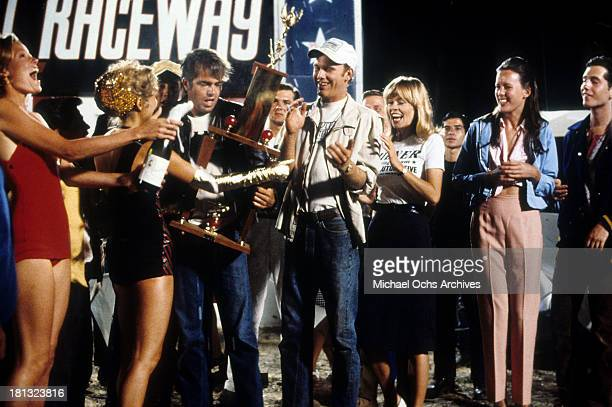 Actor Paul Le Mat and Ron Howard and actress Anna Bjorn on the set of Universal Studios movie More American Graffiti in 1979