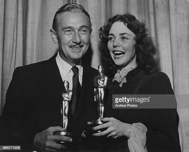 Actor Paul Lukas holding his Best Actor award for the film 'Watch on the Rhine' with actress Jennifer Jones holding her Best Actress award for the...