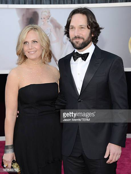 Actor Paul Rudd and wife Julie Yaeger arrive at the Oscars at Hollywood Highland Center on February 24 2013 in Hollywood California