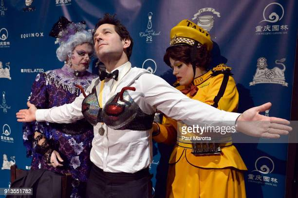 Actor Paul Rudd receives the Hasty Pudding Theatricals Man of The Year award from Harvard University students Aaron Slipper and Derek Speedy during...