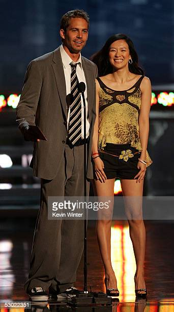 Actor Paul Walker and Actress Ziyi Zhang onstage during the 2005 MTV Movie Awards at the Shrine Auditorium on June 4, 2005 in Los Angeles,...