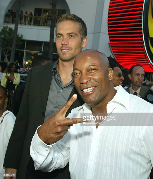 Actor Paul Walker and director John Singleton arrive at the premiere of 2 Fast 2 Furious at the Universal Amphitheatre on June 3 2003 in Los Angeles...