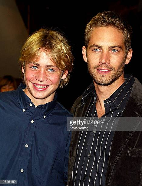 Actor Paul Walker and his brother Cody arrive at the premiere of 'Timeline' at the National Theatre on November 19 2003 in Los Angeles California