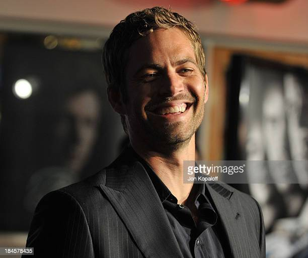 """Actor Paul Walker arrives at the Los Angeles Premiere """"Fast & Furious"""" at the Gibson Amphitheatre on March 12, 2009 in Universal City, California."""