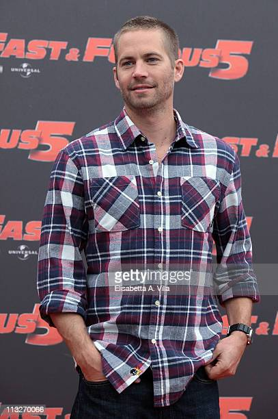 """Actor Paul Walker attends """"Fast & Furious 5"""" photocall at the Hassler Hotel on April 29, 2011 in Rome, Italy."""