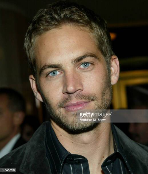 Actor Paul Walker attends the film premiere of 'Timeline' at the Mann's National Theatre on November 19 2003 in Westwood California The film...