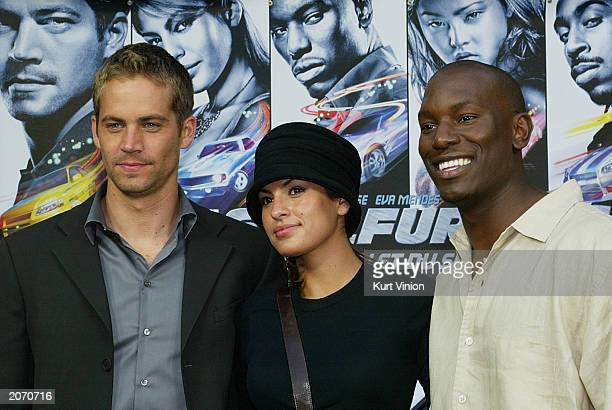 """June 10: Actor Paul Walker , Eva Mendes and actor Tyrese attend the opening of the new film """"2 Fast 2 Furious"""" June 10, 2003 in Berlin, Germany. The..."""
