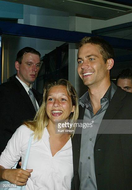 """June 10: Actor Paul Walker poses with fan Marie Wicklein at the opening of the new film """"2 Fast 2 Furious"""" June 10, 2003 in Berlin, Germany. The..."""