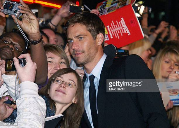 Actor Paul Walker poses with fans as he arrives for the British Premiere of his latest film, 'Fast & Furious' in London's Leicester Square on March...
