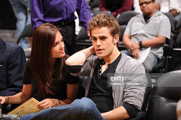 Actor Paul Wesley and girlfriend Torrey DeVitto attend a game between the Utah Jazz and the Los Angeles Lakers in Game Two of the Western Conference...