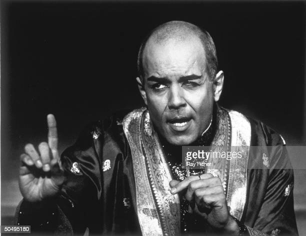 Actor Pernell Roberts as the King in scene from stock production of musical The King and I