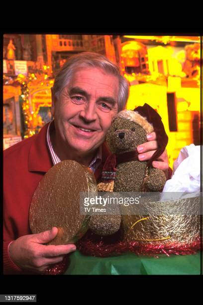Actor Peter Baldwin photographed with a teddy bear at Benjamin Pollock's Toyshop in London, circa 1999.