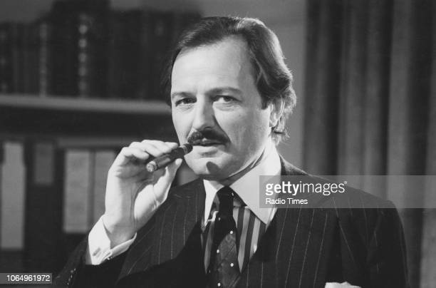 Actor Peter Bowles smoking a cigar in a scene from the television sitcom 'To the Manor Born' October 4th 1981