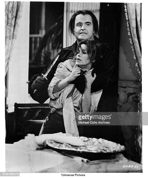 Actor Peter Boyle and actress Genevieve Bujold in a scene from the Universal Pictures movie Swashbuckler circa 1976