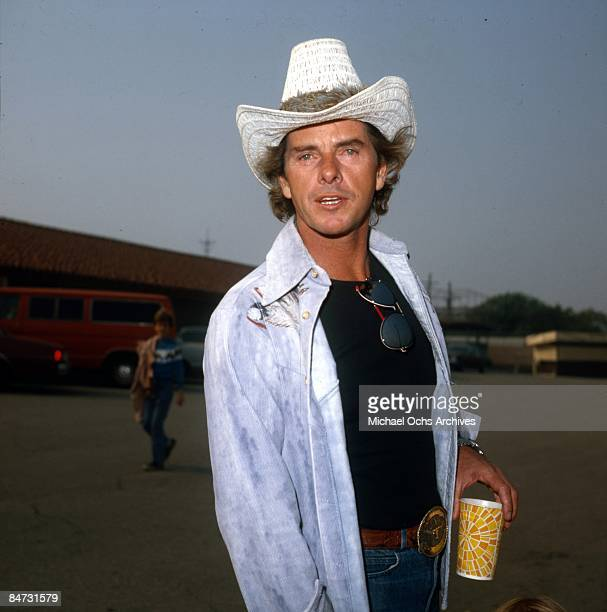 Actor Peter Brown poses for a portrait wearing a cowboy hat in circa 1979