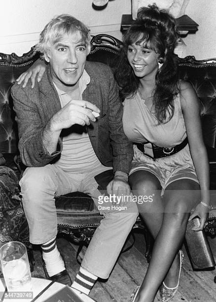 Actor Peter Cook and model Maria Whittaker at the Hippodrome London July 7th 1987