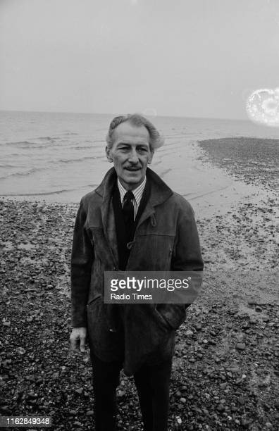 Actor Peter Cushing standing by the sea near his home to promote the BBC Radio 4 series 'Sounds Natural', where he talks about the British...