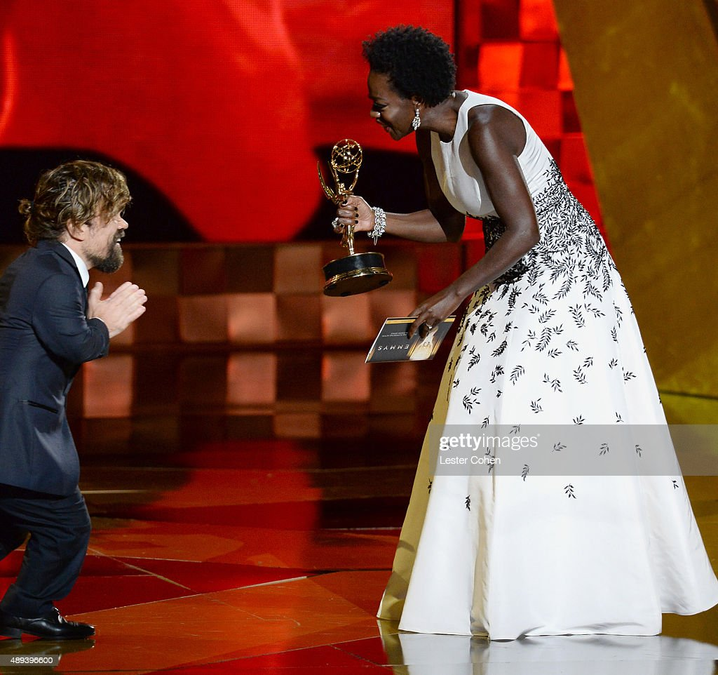 Actor Peter Dinklage (L) accepts an award from actress Viola Davis onstage during the 67th Annual Primetime Emmy Awards at Microsoft Theater on September 20, 2015 in Los Angeles, California.