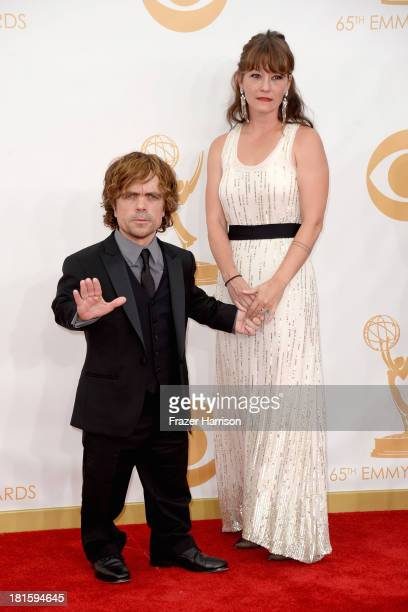 Actor Peter Dinklage and Erica Schmidt arrive at the 65th Annual Primetime Emmy Awards held at Nokia Theatre LA Live on September 22 2013 in Los...