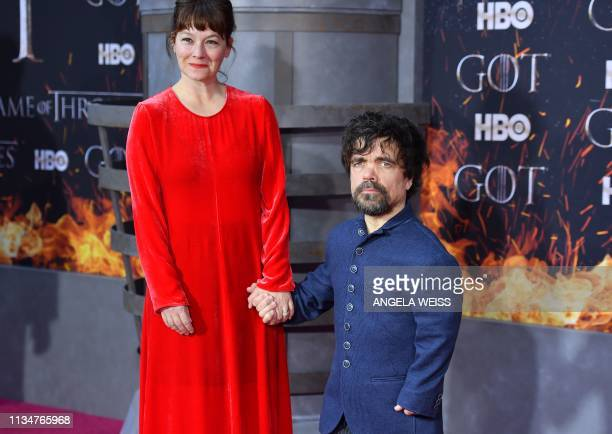 US actor Peter Dinklage and his wife Erica Schmidt arrive for the Game of Thrones eighth and final season premiere at Radio City Music Hall on April...