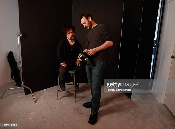 Actor Peter Dinklage and photographer Jeff Vespa behind the scenes in the WireImage Portrait Studio at ATT At The Lift during the 2017 Sundance Film...