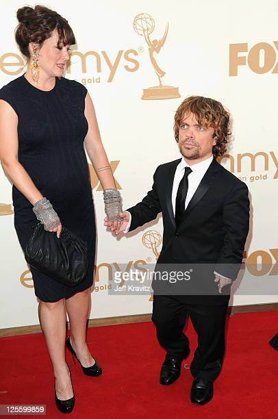 Actor Peter Dinklage and wife Erica Schmidt arrive at the 63rd Primetime Emmy Awards at Nokia Theatre LA Live on September 18 2011 in Los Angeles...