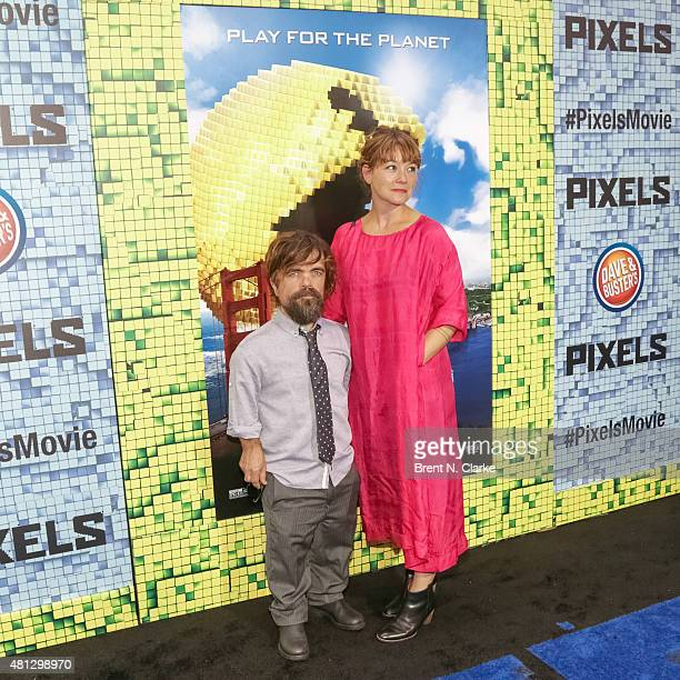 Actor Peter Dinklage and wife Erica Schmidt arrive at the Pixels New York premiere held at the Regal EWalk on July 18 2015 in New York City