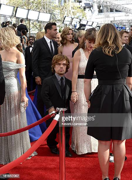 Actor Peter Dinklage and wife Erica Schmidt arrives at the 65th Annual Primetime Emmy Awards held at Nokia Theatre LA Live on September 22 2013 in...