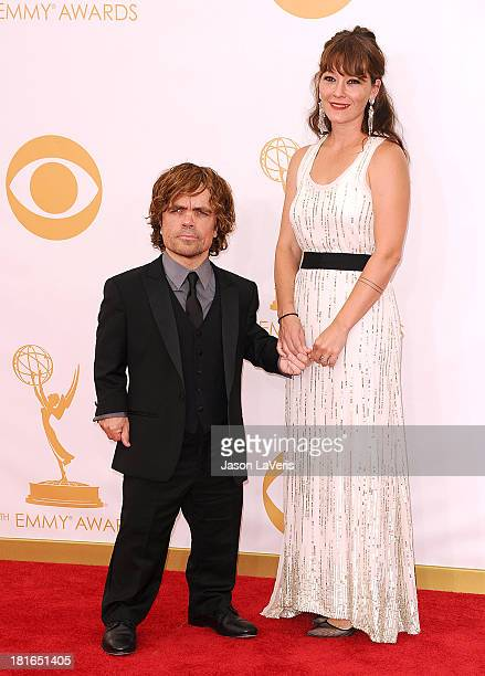 Actor Peter Dinklage and wife Erica Schmidt attend the 65th annual Primetime Emmy Awards at Nokia Theatre LA Live on September 22 2013 in Los Angeles...