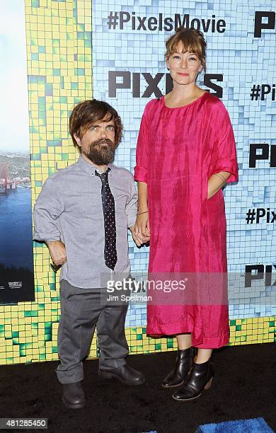 Actor Peter Dinklage and wife Erica Schmidt attend the Pixels New York premiere at Regal EWalk on July 18 2015 in New York City