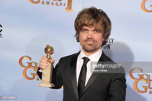 Actor Peter Dinklage poses in the press room with the Best Performance by an Actor in a Supporting Role in a Series MiniSeries or Motion Picture Made...